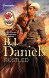 Rustled (Whitehorse, MT: Chisholm Cattle Co., #3)