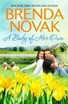 A Baby of Her Own (Dundee, Idaho, #1)