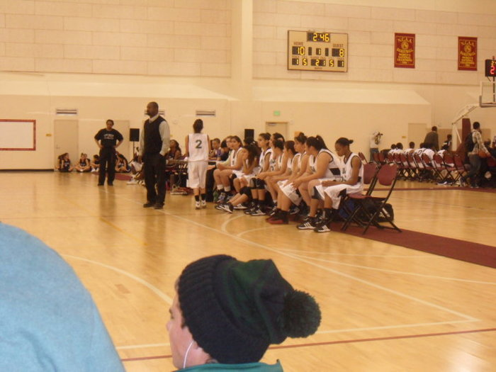 This is a photo of me coaching at the last high school I was employed. We played our season ending game at the practice courts at University of Southern Cal. Yes...USC Trojans. We won and had a great experience.