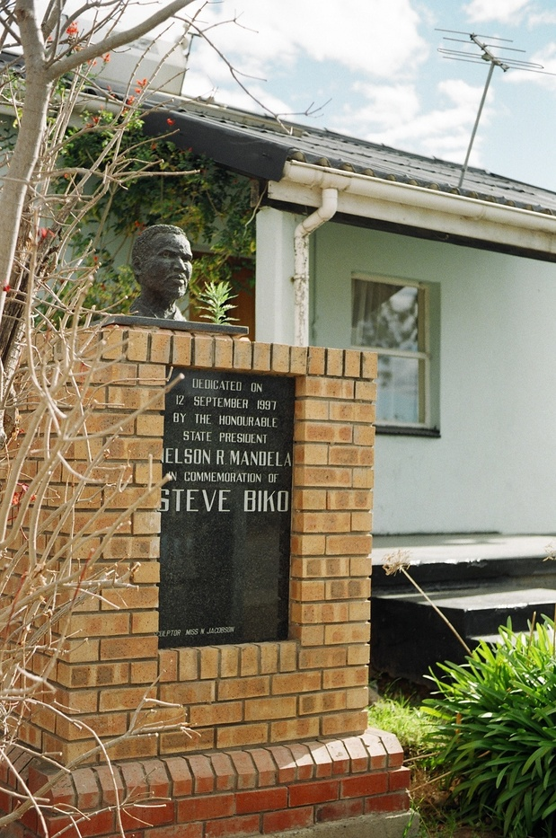 Monument to the South African anti-Apartheid martyr Steve Biko outside the house, in which he lived whilst under house arrest, in Ginsberg Township next to King Williams Town in South Africa.  August 2003
