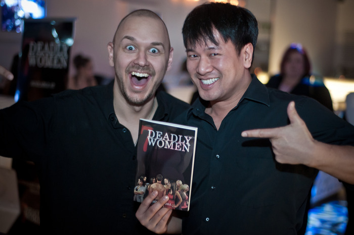 This is a picture from the book release event of the author with fan, Tri Cao.