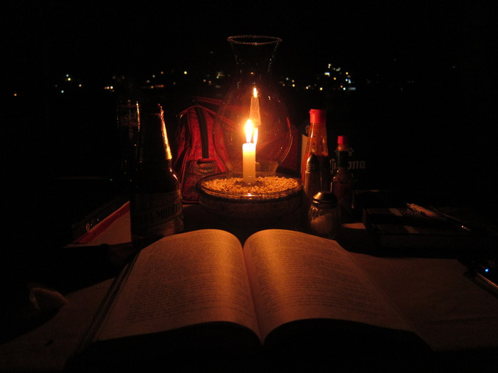 """In my mind's eye, this is what it might look like to read """"The Magician King"""" by candlelight on the deck of the Muntjac.  (Photo taken by me, Mark McClelland, on the beach in Yelapa, Mexico.)"""